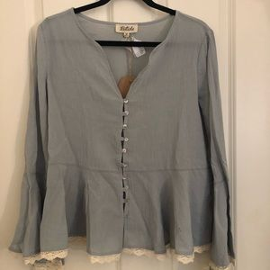 Boutique blouse with flare sleeves. Size large.